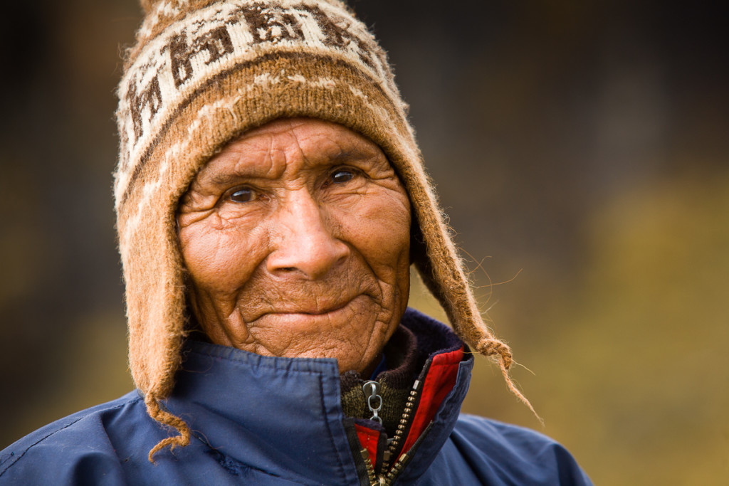A local Aymara Indian smiles toward the camera in Bolivia