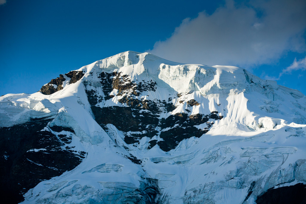 The glacier-covered summit of Mt. Sunchuli (17,200'/5,300m) in the Apolobamba Range in Bolivia during winter.