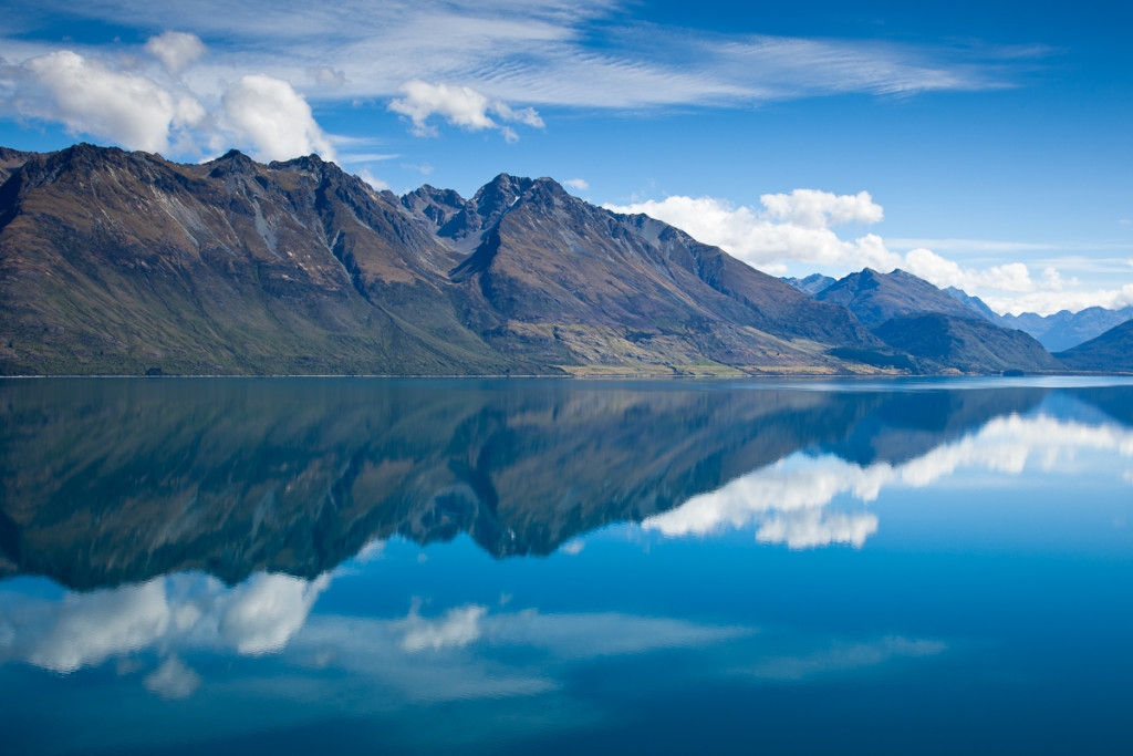 Mirror-like reflections on Lake Wakatipu near Glenorchy in New Z
