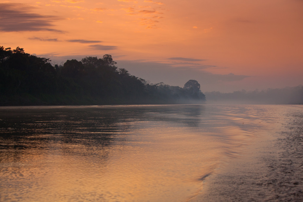 A sunrise departure on the Tambopata River in Tambopata Reserve