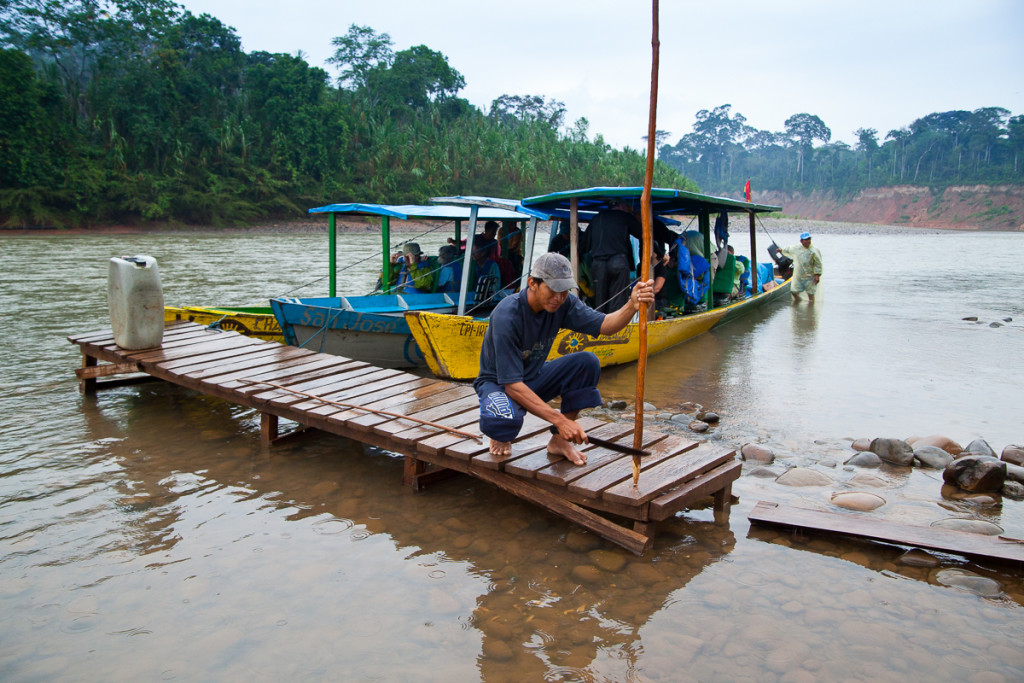 Tourists and guides travel via motorized canoe on the Beni & Tui