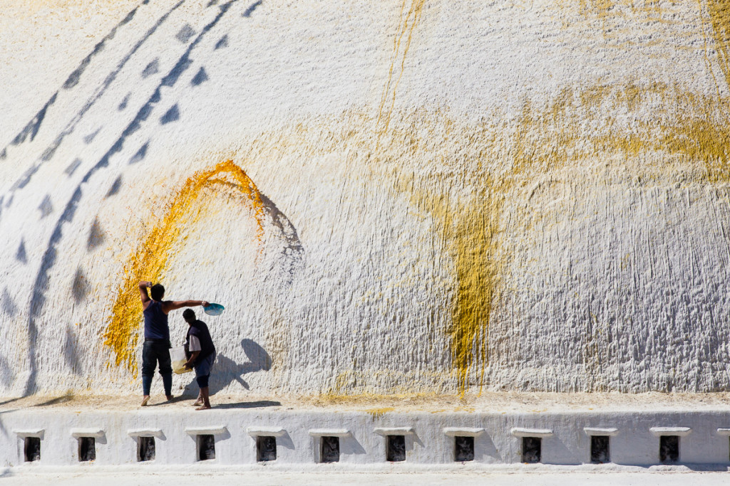 A Nepali crew of painters toss colored flower water onto the Boudhanath Stupa, during the Nepali new year celebration, thus asking for health, good luck and blessings, in Kathmandu, Nepal.