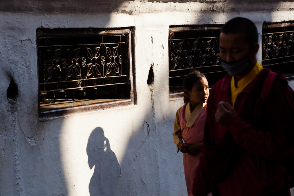 Buddsit devotees from Tibet walk clock-wise at the foot of the stupa at Boudhanath, during the Tibetan New Year in Kathmandu, Nepal.