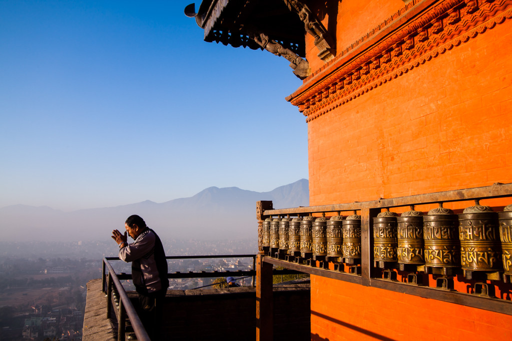 Early morning greets a worshipper with a warm glow at the Swoyambhunath temple in Kathmandu, Nepal.