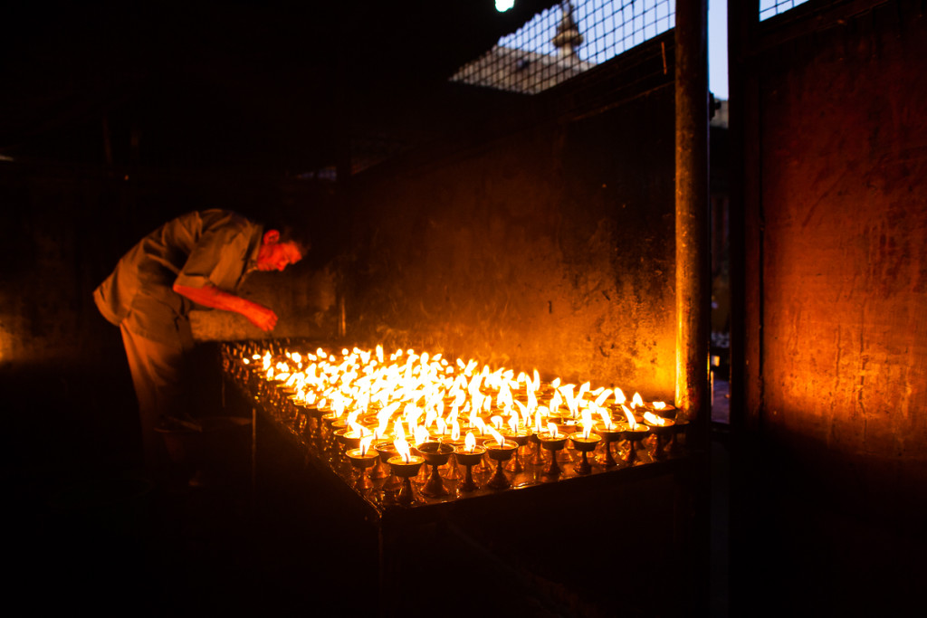 As people come to pray and light butter lamps at the Boudhanath Stupa, the people who are charged with keeping the prayers alive actively keep the butter lamps lit in a back room in Kathmandu, Nepal.