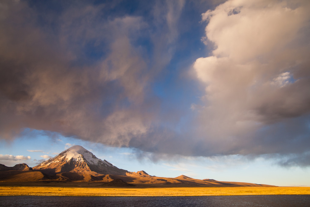 Mt. Sajama catches the last rays of sun at sunset, illuminating